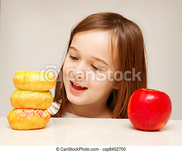 This photo depicts a young girl making decisions betwen healthy y food and unhealthy food. - csp8452700
