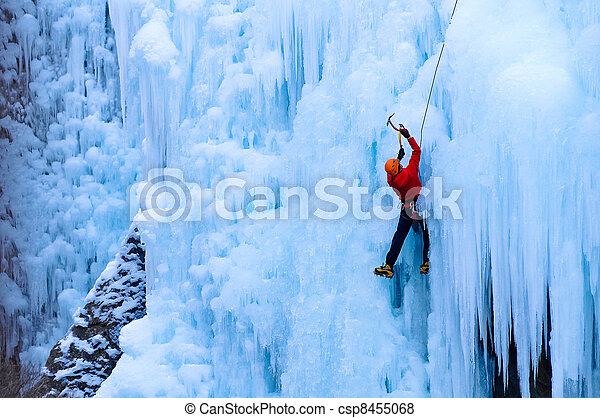 athletic male in red coat climbing ice in the Uncomphagre Gorge - csp8455068