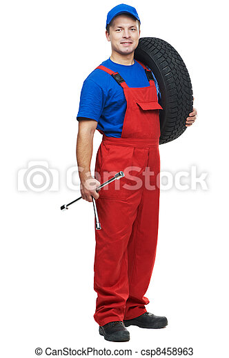 automobile mechanic with car tire and spanner - csp8458963