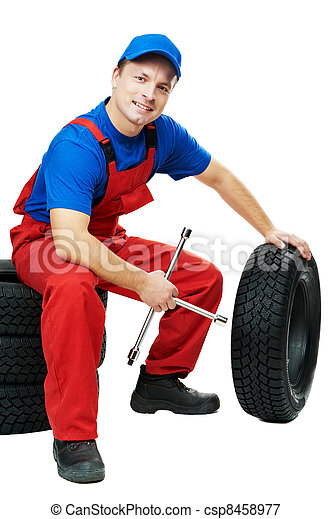 automobile mechanic with car tire and spanner - csp8458977
