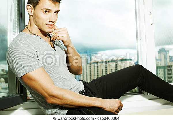 man on a window sill - csp8460364