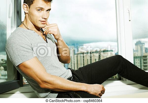 man on a window sill - csp8460364