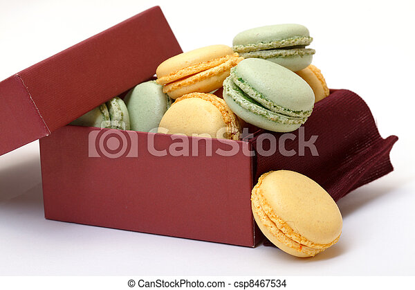 Colorful Macaron in paper box on white background - csp8467534