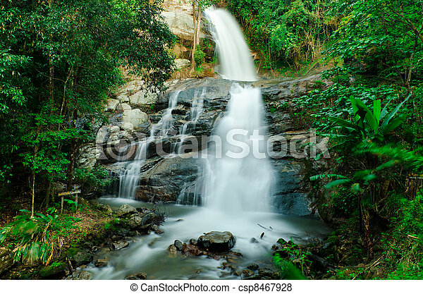 Waterfall in a forest on the mountain - csp8467928