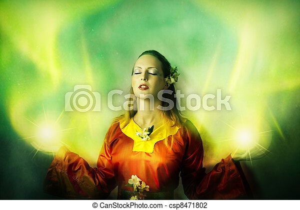 Young woman elf or witch making magic - csp8471802