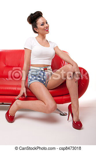 Pert Pinup Girl On Red Sofa - csp8473018