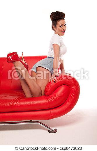 Pert Pinup Girl On Red Sofa - csp8473020
