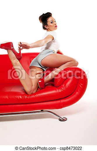 Pert Pinup Girl On Red Sofa - csp8473022