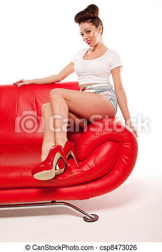 Pert Pinup Girl On Red Sofa - csp8473026