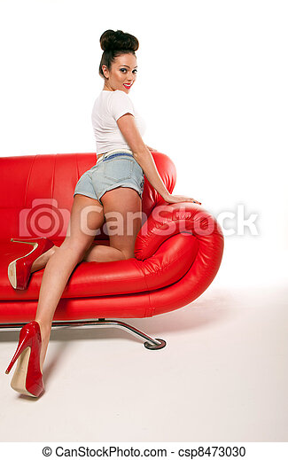Pert Pinup Girl On Red Sofa - csp8473030