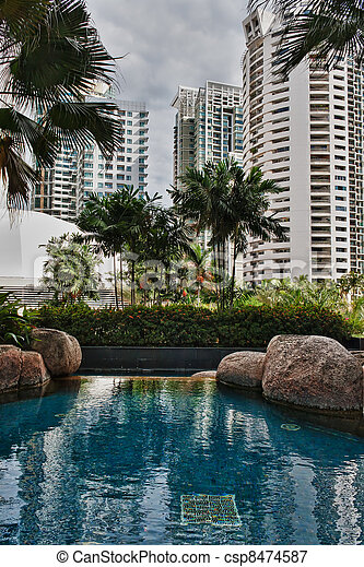 swimming pool with views of the skyscrapers - csp8474587