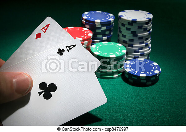 Looking at pocket aces during a poker game. - csp8476997