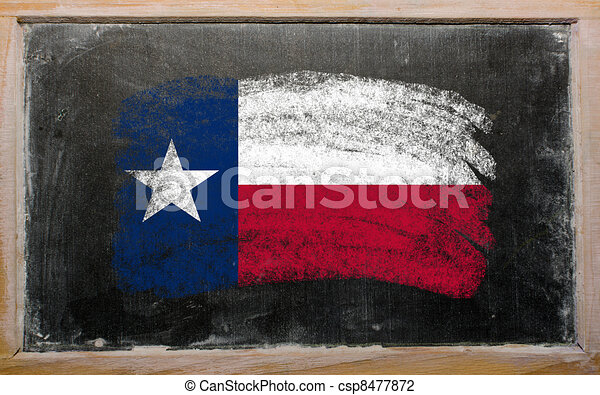 flag of US state of texas on blackboard painted with chalk - csp8477872