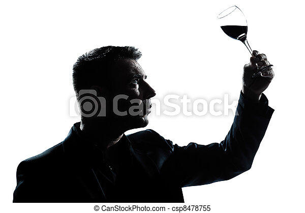silhouette man tasting  looking at his glass of red wine - csp8478755