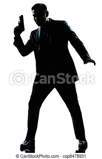 silhouette man spy holding gun - csp8478931