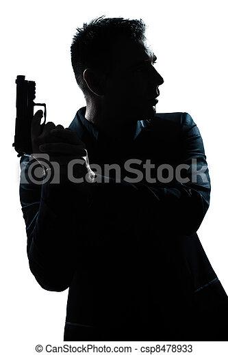 silhouette man portrait with gun - csp8478933