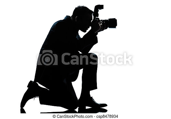 silhouette man kneeling photographer - csp8478934