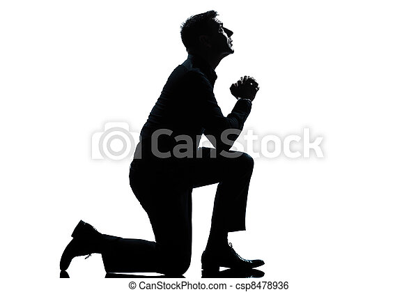 silhouette man kneeling praying  full length - csp8478936