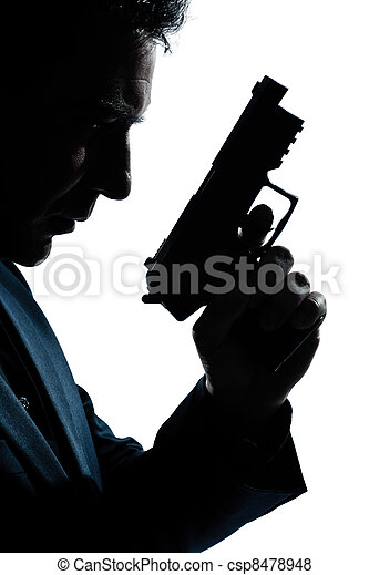 silhouette man portrait with gun - csp8478948