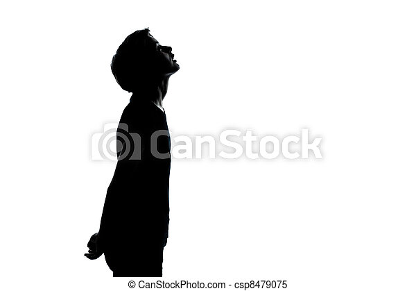 one young teenager boy or girl looking up silhouette - csp8479075