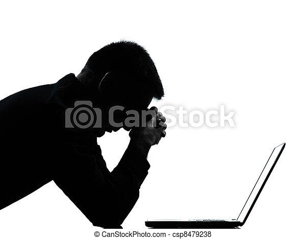 one caucasian business man computing computer laptop despair sad portrait silhouette in studio isolated on white background - csp8479238