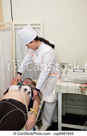 doctor making cardiology test - csp8481644