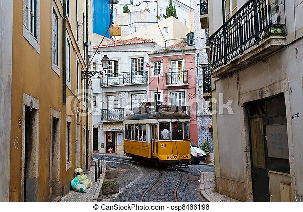 Classic Yellow Tram in Alfama quater in Lisbon, Portugal - csp8486198