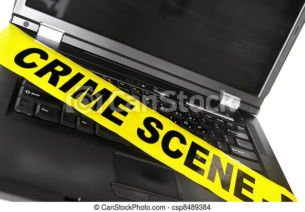 laptop computer with yellow crime scene tape - csp8489384