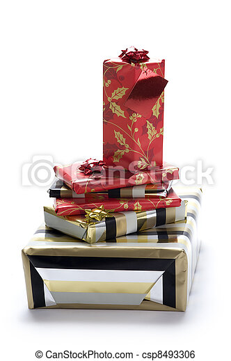 a pile of wrapped Christmas or Xmas gifts or presents isolated on a white background - csp8493306