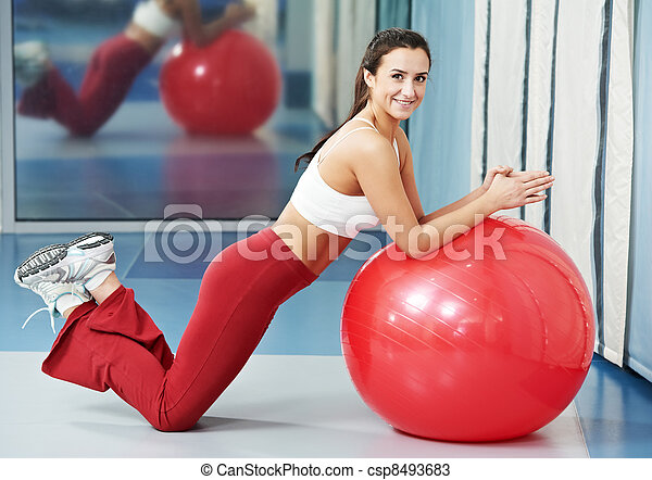Happy healthy woman with fitness ball - csp8493683
