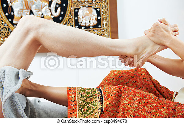 Traditional thai massage health care foot kneading - csp8494070