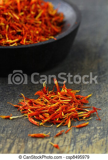 saffron treads in pile, on black - csp8495979