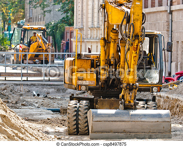 Big excavators at urban construction site - csp8497875