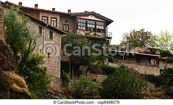 Stone building built on a mountain - csp8498079