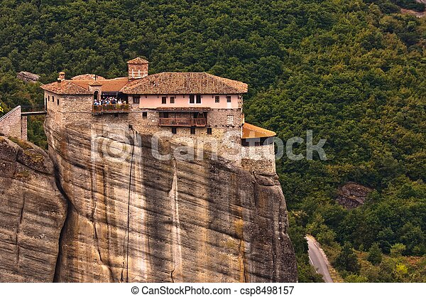 Stone building built on a mountain - csp8498157
