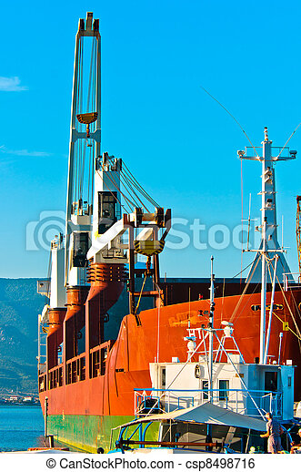 Big transportation boat at the bay against blue sky - csp8498716