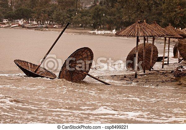 A dirty polluted beach  in the rain - csp8499221