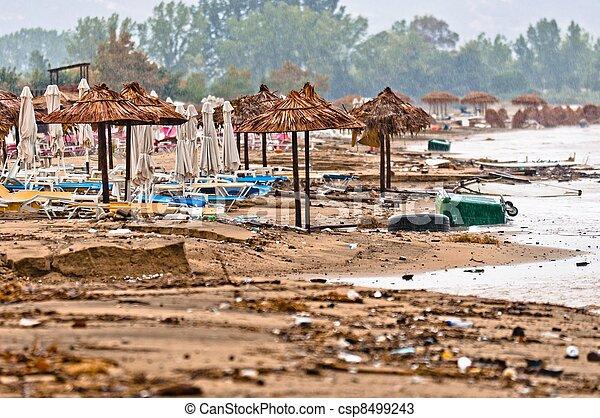 A dirty polluted beach  in the rain - csp8499243