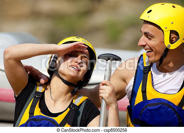 Happy couple rafting equipment - csp8500256