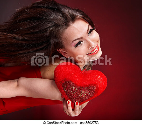 Girl with heart  in red flying. Valentines day. - csp8502753