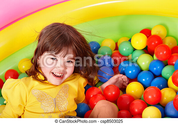 Happy child in group colourful ball. - csp8503025