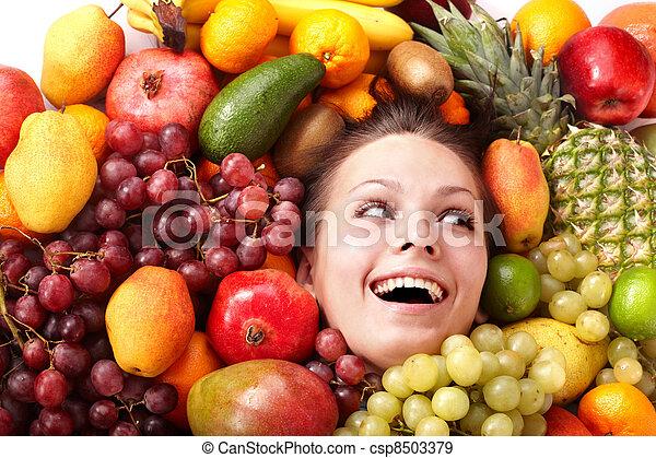 Girl in group of fruit. - csp8503379