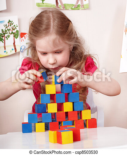 Child preschooler play wood block in play room. - csp8503530