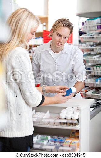 Pharmacist Helping Customer - csp8504945
