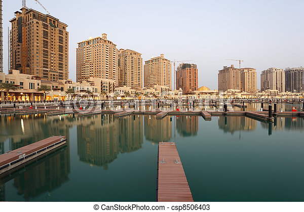 Residential buildings and empty Marina at The Pearl in Doha, Qatar - csp8506403