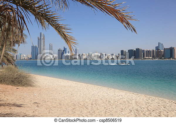 Beach and the skyline of Abu Dhabi, United Arab Emirates - csp8506519