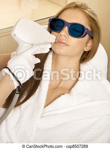 Laser hair removal in professional beauty studio. beauty parlor - csp8507289