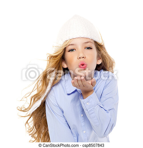 beautiful winter kid girl blowing wind with lips - csp8507843