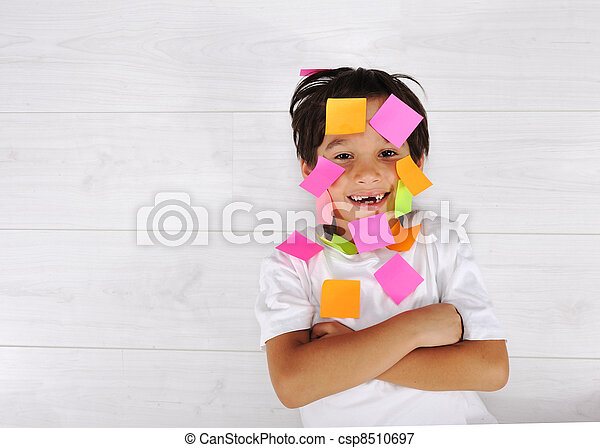 Little boy with memo posts on his face - csp8510697