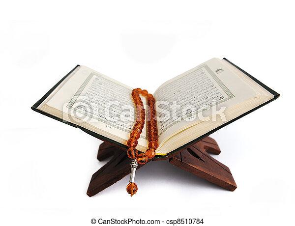 Koran, the holy islamic book isolated - csp8510784